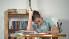 Upset schoolboy doing homework. Teen depression stock video