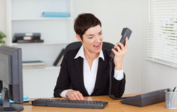 Upset secretary calling Royalty Free Stock Photo