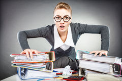 Upset secretary at her desk. Royalty Free Stock Images