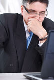Upset senior businessman  working Stock Image