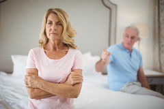 Upset senior couple arguing in bedroom Royalty Free Stock Image