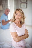 Upset senior couple arguing in bedroom Royalty Free Stock Images