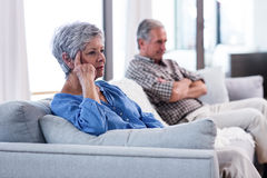 Upset senior couple ignoring each other Stock Photos