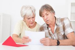 Upset senior couple with letter Royalty Free Stock Photography