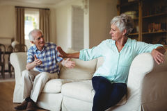Upset senior couple in to an argument in living room Royalty Free Stock Photos
