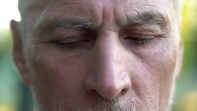 Upset senior male thinking about future, retirement and hopelessness, closeup royalty free stock photography