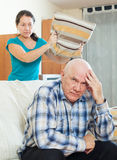 Upset senior man against angry woman Stock Photos