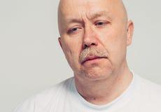 Upset senior man portrait depression isolated white Royalty Free Stock Photos