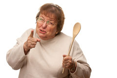 Upset Senior Woman with The Wooden Spoon Stock Photos