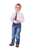 Upset small kid on white. Full-length upset small boy in glasses, jeans and white shirt isolated on white background Royalty Free Stock Photography