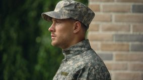 Upset soldier remembering military service, social program to support veterans. Stock footage stock footage