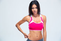 Upset sports woman touching her belly fat Stock Images
