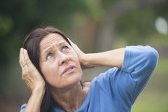 Upset stressed mature woman outdoor Obrazy Stock