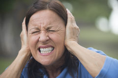 Upset stressed mature woman outdoor obrazy royalty free