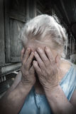 Upset stressed old  woman. Upset and unhappy  senior woman with her hands over the face Stock Image