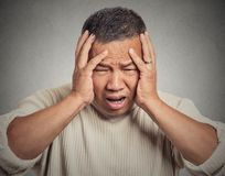 Upset, stressed out, sick, tired middle aged man having headache Royalty Free Stock Photo