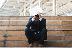Free Upset Stressed Young Asian Business Man Sitting On Stairs And Suffering From Severe Depression. Unemployment And Layoff Concept Royalty Free Stock Photo - 158616405