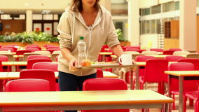 Upset student eating lunch alone stock video footage