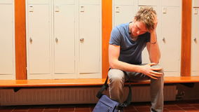 Upset student holding his head. While sitting on a bench stock video footage