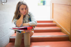Upset student sitting on stairs Stock Photos