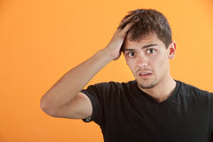 Upset Teen. Upset Hispanic teen male with hand on head Royalty Free Stock Images
