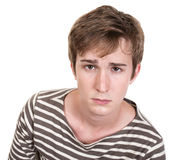 Upset Teen. Sad Caucasian teen isolated over white background Royalty Free Stock Photo
