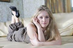 Upset teen girl lying on sofa Royalty Free Stock Image