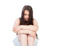 Upset teen girl with sad face. Isolated on white background Royalty Free Stock Photo