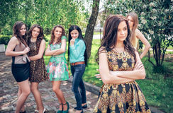 Upset teenage girl with friends gossiping royalty free stock photos