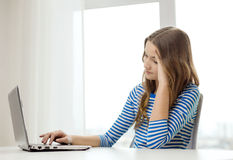 Upset teenage gitl with laptop computer at home Stock Photos