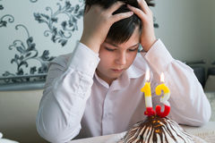 Upset teenager alone marks a thirtieth birthday. Upset teenager alone marks the thirtieth birthday Stock Photos