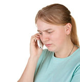 Upset teenager gets bad phone call Royalty Free Stock Photography