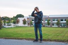 Upset teenager listening to music. stock photo