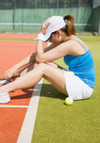 Upset tennis player sitting on court Stock Images