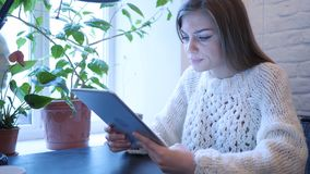 Upset Tense Woman Using Tablet for Browsing stock images