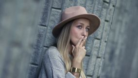 Upset thougthful girl smoking cigarette stock footage
