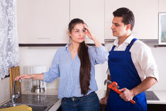 Upset woman annoying handymen with complains Royalty Free Stock Photos