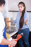 Upset woman annoying handymen with complains Royalty Free Stock Images