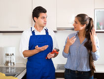 Upset woman annoying handymen with complains Stock Images