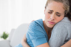 Upset woman being consoled by her friend Stock Photo
