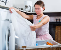 Upset woman cannot wash stains Stock Image
