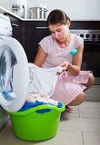 Upset woman cannot wash stains Stock Images