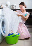 Upset woman cannot wash stains Stock Photography