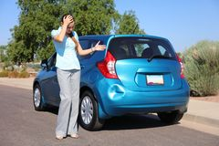 Upset Woman After Car Accident. Female driver in distress after car accident/hit-and-run royalty free stock photography