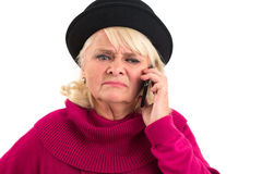 Upset woman with cell phone. Royalty Free Stock Photography