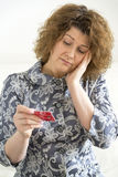 Upset woman with  credit card Royalty Free Stock Photo
