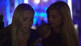 Upset woman crying, suffering depression, female rejoicing at friend's problem. Stock footage stock footage