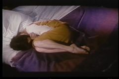Upset woman curled up on bed stock video