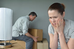 Upset woman do not want to move to a new home. Upset women (age 30-40) do not want to move to a new home. Moving house concept. Real people. copy space Royalty Free Stock Photo
