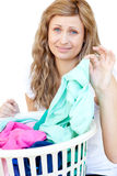 Upset woman doing laundry Royalty Free Stock Photos